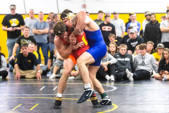 Cash Wilcke, in the red, and Abe Assad, blue, finished third and second, respectively, at the 2019 Midlands Championships at 184 pounds. Wilcke defeated Nelson Brands on his way to third. Iowa coach Tom Brands will have a tough decision to make when it comes to naming a starter for the rest of the year.