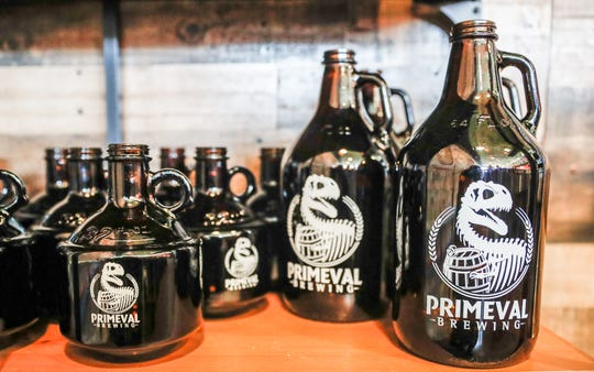 Growlers sport the logo of Primeval Brewing, a new brew pub in Noblesville.