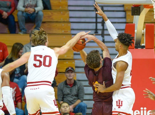 Hoosiers forwards Joey Brunk (50) and Trayce Jackson-Davis (4) combine to block the shot against Gannon in an exhibition game.