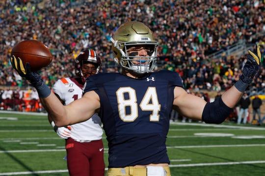 Notre Dame tight end Cole Kmet (84) celebrates an 8-yard touchdown reception against Virginia Tech.