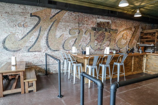 An original advertisement for Maxwell automobiles has been restored and now decorates Primeval Brewing in Noblesville.