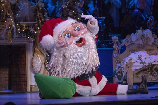 Santa does the splits during a musical number Sunday at Yuletide Celebration, which showcases the Indianapolis Symphony Orchestra at Hilbert Circle Theater.