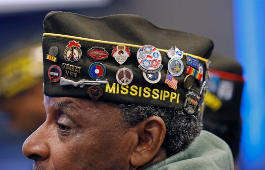 Harold Grant of Jackson, Miss, 71, an Army veteran, who served in Vietnam in 1968, wears his heavily decorated VFW garrison cap during an early Veteran's Day ceremony at the Museum of Mississippi History and Mississippi Civil Rights Museum in Jackson, Miss., Nov. 8, 2019.