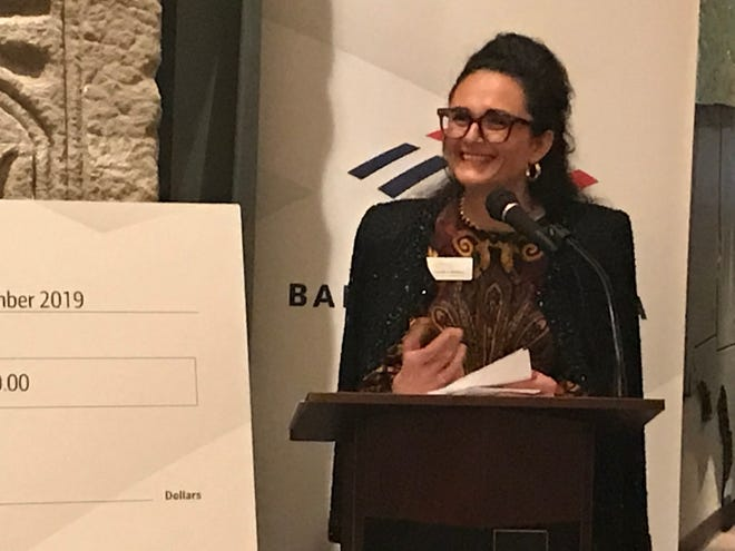 Claudia Caballero, executive director of Centro Hispano de East Tennessee, accepts the first Neighborhood Champions grant from Bank of America on Thursday, Nov. 7, 2019.