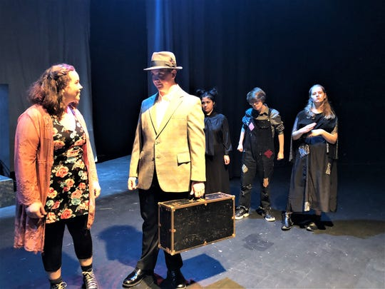 """""""Eurydice,"""" played by Maia Koontz, has forgotten everything when she travels to the underworld after she dies. Eurydice does not recognize her father, played by Brett Beard, and treats him as a porter as """"The Stones"""" look on."""