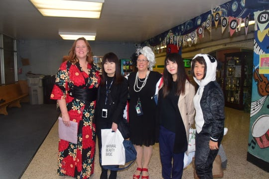 Chaperones and members of the Muroran Club arrive at Cedar Bluff Middle School for a special assembly to welcome seven students from Japan on Thursday, Oct. 31. From left are Aimee Bridges, CBMS school counselor; Miki Mima, teacher at Ohren Junior High in Muroran, Japan; Terry Nieporte, CBMS principal; Yukina Hori, Muroran city worker with special needs population; and Kumi Alderman, Director of Knoxville Asian Festival and delegation interpreter.