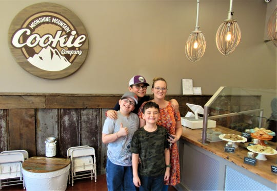 Nicholas Perry gives a thumbs-up to Moonshine Mountain Cookies as his older brother Jordan, mom Nikki Perry and young Zachary decide on their selections.