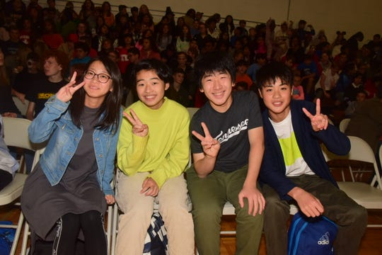 Delegates from Muroran, Japan, are all smiles at a welcoming assembly held at Cedar Bluff Middle School on Thursday, Oct. 31. From left are Kaede Inoue, Shion Ito, Rintaro Ishioka, and Yamato Suzuki