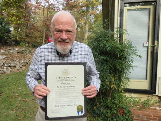 Dr. Charles Faulkner, who was recently honored by the Daughters of the American Revolution and the city of Knoxville for his archaeological and historical research of area pioneer sites, holds up a certificate proclaiming Nov. 3 as Dr. Charles Faulkner Day in Knoxville.