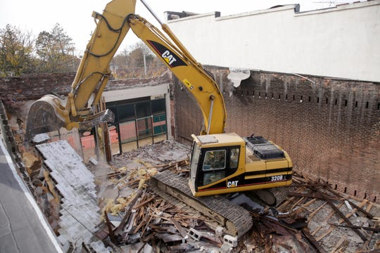 An excavator tears down 1626 and 1628 Main st., Friday, Nov. 8, 2019, in Lafayette.