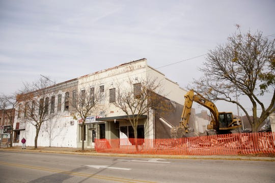 An excavator tears down 1626 and 1628 Main st. before demotion is set to begin on the E.M. Weaver Building, at left, next week, Friday, Nov. 8, 2019, in Lafayette.