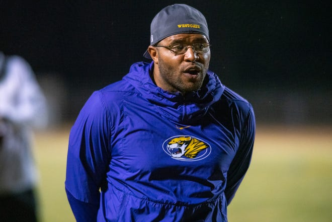 Westgate High's head coach Ryan Antoine calls for an official in between plays as the Carencro High Golden Bears take on the Westgate High Tigers on Thursday, Nov. 7, 2019.