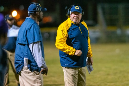 Carencro High's head coach Tony Courville disputes with an assistant coach on the sideines as the Carencro High Golden Bears take on the Westgate High Tigers on Thursday, Nov. 7, 2019.