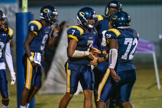 Carencro High's offense congratulates Kendrell Williams (7) after his touchdown score as the Carencro High Golden Bears take on the Westgate High Tigers on Thursday, Nov. 7, 2019.