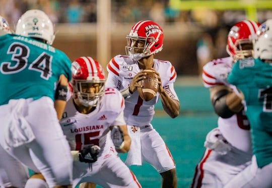 Louisiana junior quarterback Levi Lewis looks to pass against the Coastal Carolina pass rush Thursday night at Brooks Stadium in Conway.