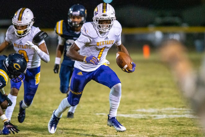 Westgate High's Kayshon Boutte runs the ball down the field as the Carencro High Golden Bears take on the Westgate High Tigers on Thursday, Nov. 7, 2019.