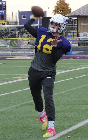 Bloom-Carroll senior quarterback Otto Kuhns throws during practice on Wednesday as the Bulldogs prepare for their Division IV, Regional 15 playoff game against Gnadenhutten Indian Valley on Saturday.