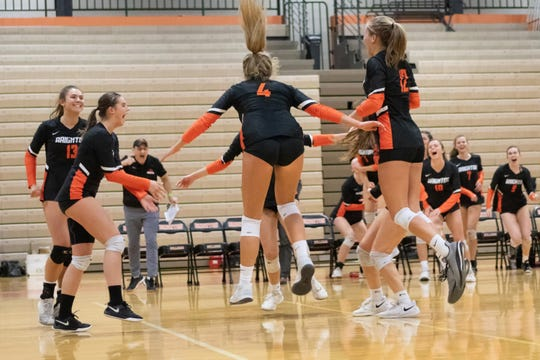Brighton celebrates after scoring the final point in a 3-0 victory over Howell in a district volleyball championship match on Thursday, Nov. 7, 2019.