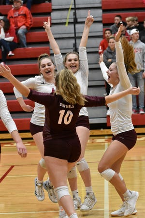 Charyl Stockwell volleyball players celebrate after beating Whitmore Lake, 3-0, for the district championship on Thursday, Nov. 7, 2019.