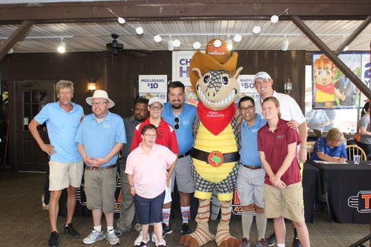 Texas Roadhouse Founder and CEO, Kent Taylor, far left, poses with athletes from Special Olympic Kentucky during the 20th Annual Armadillo Classic in Louisville. Also shown is Andy Armadillo. Special Olympics Kentucky is the company's longest serving non-profit partner.