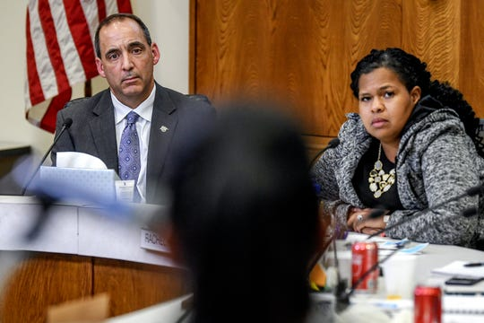 Former Lansing School District acting superintendent Mark Coscarella, left, and board president Rachel Willis, right, listen during public comment at a Lansing School District Board of Education meeting on Thursday, Nov. 7, 2019, at the Shirley M. Rodgers Administration Building in Lansing.