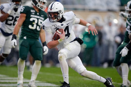 Penn State quarterback Sean Clifford, center, scores on a two-point conversion against Michigan State during the second quarter of an NCAA college football game, Saturday, Oct. 26, 2019, in East Lansing, Mich. (AP Photo/Al Goldis)