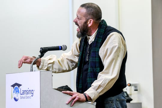 Talib Cornelius speaks about acting superintendent Mark Coscarella during public comment at a Lansing School District Board of Education meeting on Thursday, Nov. 7, 2019, at the Shirley M. Rodgers Administration Building in Lansing. The meeting was the first after sexual harassment allegations came out against Coscarella.