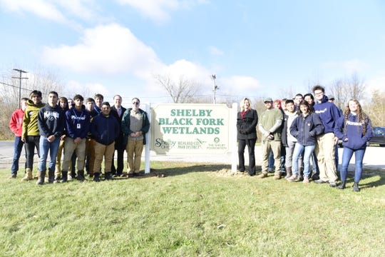 Students from the Pioneer Career and Technology Center helped install a few new signs along the trails at the Shelby Black Fork Wetlands.