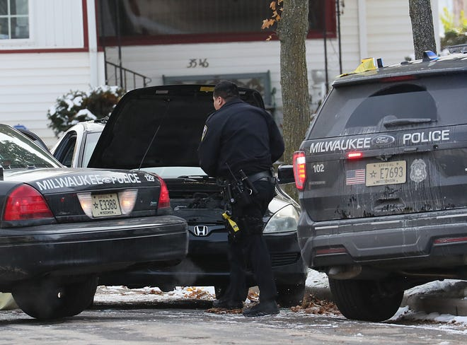 Police investigate a vehicle in the 3500 block of North 22nd street in Milwaukee.