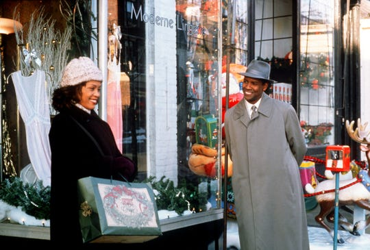"Denzel Washington, right, is an angel come to Earth who charms Whitney Houston during the Christmas season in ""The Preacher's Wife."""