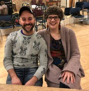 """Choreographer David Roman, left, and director Molly Rhode pose for a photo in the rehearsal hall for """"Newsies,"""" staged by Skylight Music Theatre."""