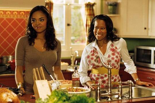 "Sharon Leal, left, and Regina King star in ""This Christmas."""