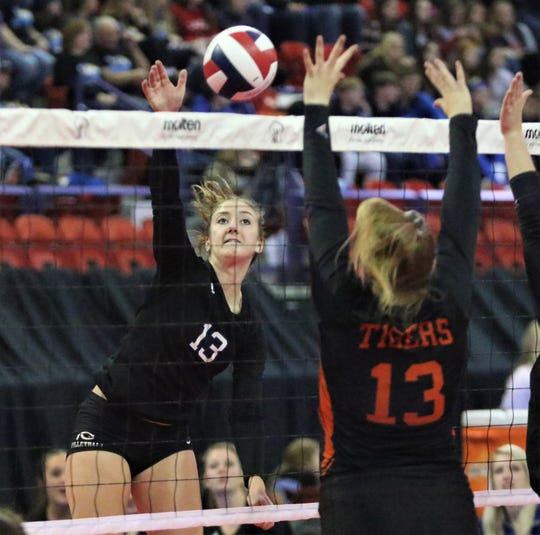 Catholic Central hitter Sammie Seib elevates for one of her record 34 kills against Hillsboro during a WIAA state semifinal match.