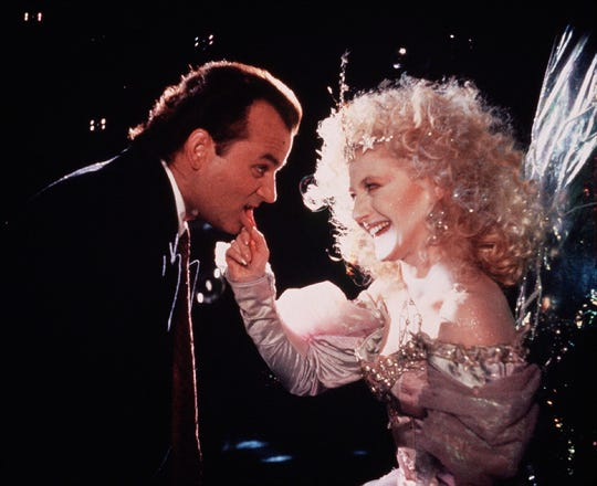 """Humbug-y TV executive Frank Cross (Bill Murray) encounters a playfully vicious Ghost of Christmas Past (Carol Kane) in """"Scrooged."""""""
