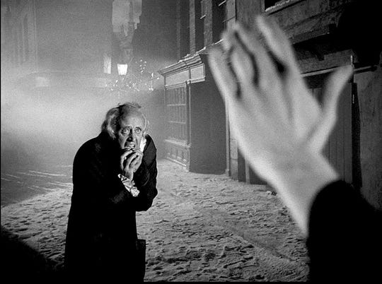 "Ebenezer Scrooge (Alastair Sim) faces the Ghost of Christmas Yet to Come in the 1951 production of ""A Christmas Carol."""