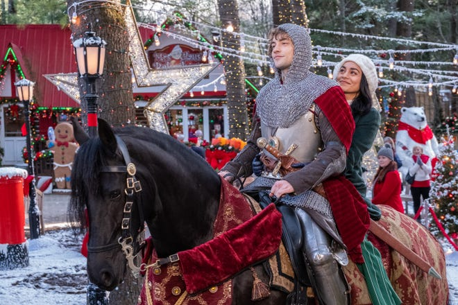 "Josh Whitehouse, left (atop horse), and Vanessa Hudgens star in Netflix's ""The Knight Before Christmas."""