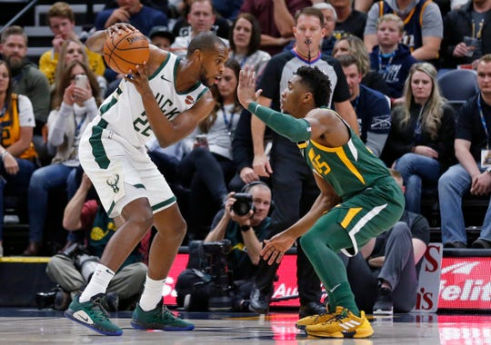 Khris Middleton and the Bucks fell to the Jazz, 115-111, in Salt Lake City in March.