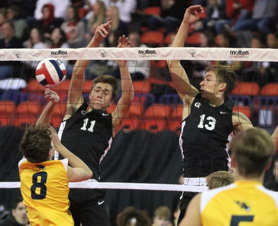 Germantown seniors Hans Stelpflug, left, and Jackson Van Engen team up for a block against Marquette during a WIAA state semifinal match at the Resch Center in Ashwaubenon on Nov. 8, 2019.