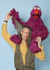 """Martin P. Robinson, who grew up in Brookfield, plays Mr. Snuffleupagus, Telly Monster, Slimeythe Worm, the Martians AKA the Yip Yips,Old MacDonald, and Frazzle on """"Sesame Street."""""""