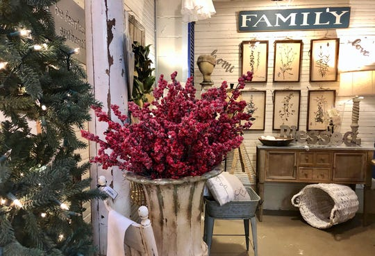 Arrange twigs, branches or berries in urns for an easy festive vignette, say the owners of Angelus Home & Garden in Walworth.