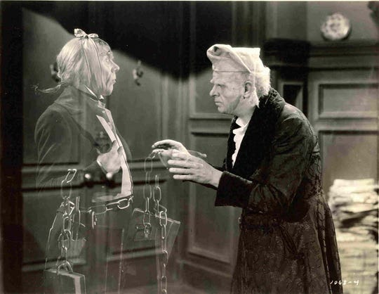 "In the 1938 version of ""A Christmas Carol,"" Reginald Owen, right, plays curmudgeonly Ebenezer Scrooge, confronted by the ghost of his former partner, Marley (played by Leo G. Carroll)."