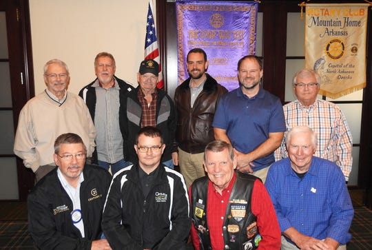 The Rotary Club of Mountain Home held a special meeting on Thursday, Nov. 7, to salute our veterans. Members and guests who have served our country were introduced and honored. The program was by Rotarians Larry and Brenda Nelson, who are also members of the Patriot Guard Riders, a motorcycle group that stands flag lines at funerals of veterans and the fallen, then escorts the heroes to their final resting place. The Nelsons showed photos from over 60 missions and shared some of their emotional memories from those rides. The response of Rotarians was tearful, somber, and appreciative of the men and women who have served this country. Pictured are: (from left) Rotarian John Schaub; guest Allen Helms; Rotarian Larry G. Nelson; and guest Bob Yunker; (second row) Schuyler Brower; guest Dale Harris; guest Sam Roork; Rotarian Scott Booth; guest Chris Cochran; and Rotarian Bruce Loveless. Not pictured: Brock Bettenhausen.