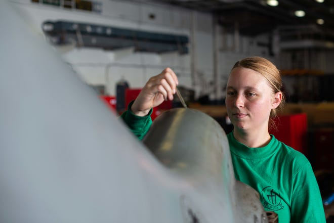 U.S. Navy Aviation Machinist's Mate 3rd Class Tabitha Brundige, a Mountain Homenative assigned to Helicopter Sea Combat Squadron (HSC) 9, conducts maintenance on an MH-60S Sea Hawk in the hangar bay aboard the aircraft carrier USS John C. Stennis (CVN 74) in the Atlantic Ocean onNov. 2. The John C. Stennis is underway conducting routine operations in support of Commander, Naval Air Force Atlantic.