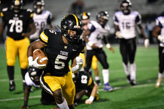 Running back Max Hunter turns up field in Neville's 56-6 win over Huntington. Hunter ran 10 times for 145 yards and three touchdowns.