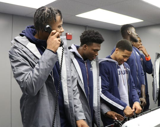 Auburn's Isaac Okoro, Tyrell Jones, J'Von McCormick and Babatunde Akingbola (from left to right) drive ship simulator at the Naval Academy in Annapolis, MD, on Nov. 8, 2019.
