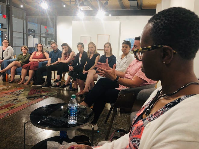 Recent visitors to the National Memorial for Peace and Justice in Montgomery talk about their experiences during a discussion led by Shakita Brook Jones, right, inside Kress on Dexter.
