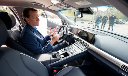 Robert Burns, of Hyundai Motor Manufacturing Alabama, shows off the interior of a vehicle at a news conference in Montgomery, Ala., on Friday November 8, 2019 where HMMA announced that they are loaning hydrogen fuel cell electric vehicles to the city of Montgomery at Riverfront Park.