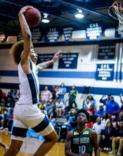 Calhoun's J.D. Davison (1) goes to the hoop late against Jeff Davis on the Calhoun campus in Letohatchee, Ala., on Thursday November 7, 2019.
