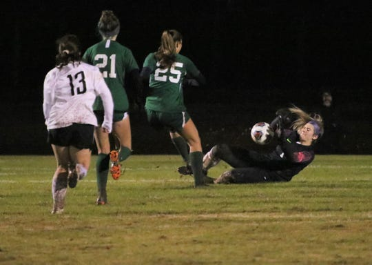 Central Magnet keeper Avery Pogue makes a sliding save following her deflection of a penalty kick just before halftime of Thursday's AA semifinals.