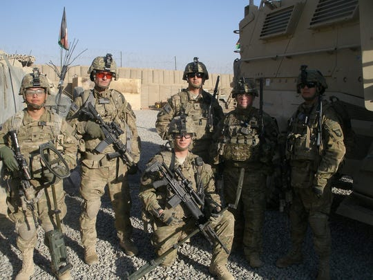 Bryan Flanery, front and center on a knee, with members of his squad at a combat outpost in Afghanistan in 2010.